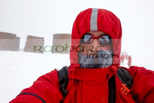man taking selfie on shore excursion to whaler's bay antarctica
