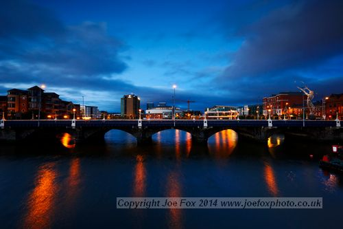 river lagan and queens bridge in the blue hour in city centre belfast ireland