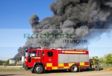 fire engine in front of a warehouse fire