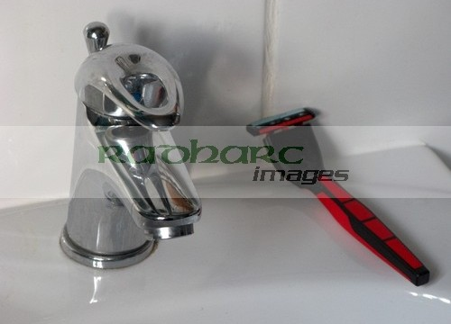 mans razor on bathroom sink