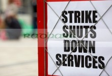 strike shuts down services newspaper headline