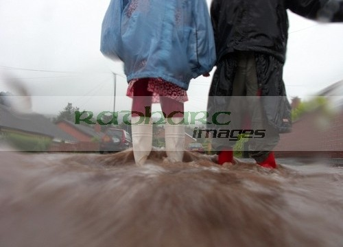children walking through flooded streets