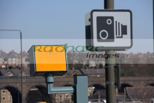 speed traffic camera and warning sign