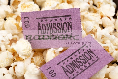 cinema entrance tickets and popcorn