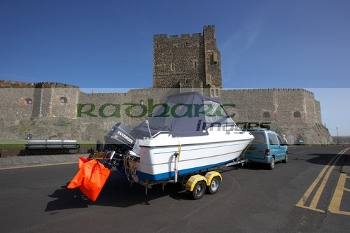 boat on trailer in front of carrickfergus castle