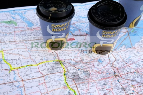 two coffee cups map of the midwestern states of the usa with route planned in highlighter on the car hood