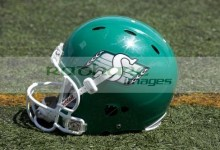 saskatchewan roughriders helmet and logo on artificial turf regina canada