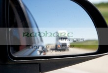 objects in mirror are closer than they appear in car side mirror with truck on highway Canada