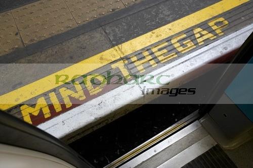 mind the gap between platform and train at london underground station england united kingdom uk
