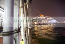 star ferry passing behind large star cruises cruise ship in busy victoria harbour hong kong hksar china asia - deliberate motion blur