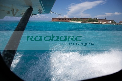 looking out of seaplane window landing on the water next to fort jefferson garden key dry tortugas florida keys usa